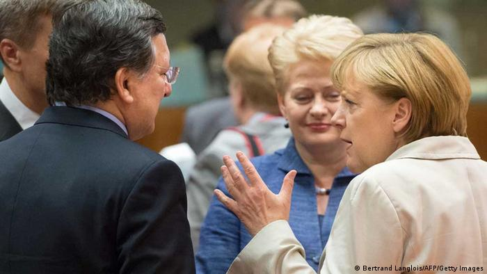 German Chancellor Angela Merkel (R) chats with European Commission President Jose Manuel Barroso (L) and Lithuanian President Dalia Grybauskaite chat prior to a roundtable meeting at the EU headquarters on June 7, 2013 in Brussels, during European Union leaders summit. European Commission President Jose Manuel Barroso on Thursday announced a political deal on the EU's hotly contested 2014-2020 trillion-euro budget, hours before an EU summit mulls how to get millions of jobless youths back into the workplace. AFP PHOTO / BERTRAND LANGLOIS (Photo credit should read BERTRAND LANGLOIS/AFP/Getty Images)