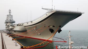 Liaoning aircraft carrier berths at a naval base in China.
