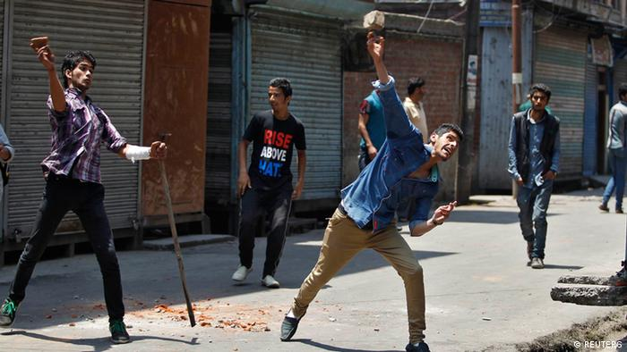 Supporters of the Jammu Kashmir Liberation Front (JKLF), a separatist party, throw stones at Indian police personnel during a clash in Srinagar May 30, 2013. (Photo: REUTERS/Danish Ismail)