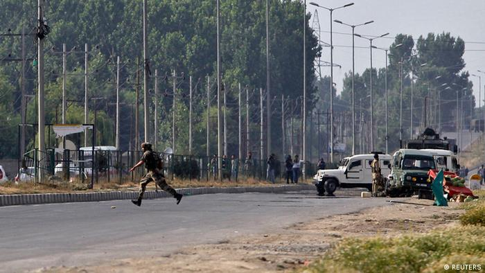 An Indian army soldier runs for cover at the scene of an encounter with separatist militants in Srinagar June 24, 2013. (Photo: REUTERS/Danish Ismail)