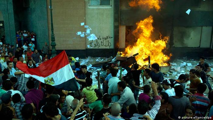 epa03765078 Egyptians opposing President Morsi starts a fire at a Muslim Brotherhood office in Alexandria , Egypt 28 June 2013. Fighting broke out between opposition marchers and Islamists in the country's second city with one person reported dead EPA/STR