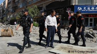 Chinese armed police patrol the streets of the Muslim Uighur quarter in Urumqi on June 29, 2013 after a series of recent terrorist attacks hit the Xinjiang region. (Photo: AFP)