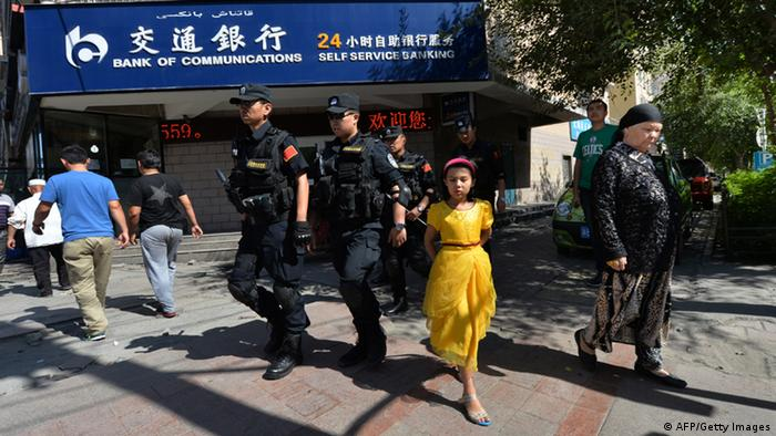 GettyImages 171834886 Chinese armed police patrol the streets of the Muslim Uighur quarter in Urumqi on June 29, 2013 after a series of recent terrorist attacks hit the Xinjiang region. China's state-run media on June 29 blamed around 100 people it branded as 'terrorists' for sparking 'riots' in the ethnically-divided region of Xinjiang, where clashes killed 35 two days earlier. AFP PHOTO / Mark RALSTON (Photo credit should read MARK RALSTON/AFP/Getty Images)