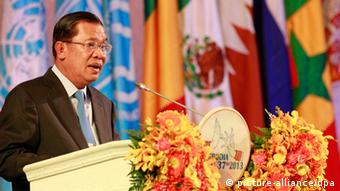 epa03747659 Cambodian Prime Minister Hun Sen speaks during the opening ceremony of the 37th session of the World Heritage Committee, Phnom Penh, Cambodia, 16 June 2013. Cambodia is hosting the 37th session of the World Heritage Committee from 16 to 27 June 2013. EPA/MAK REMISSA