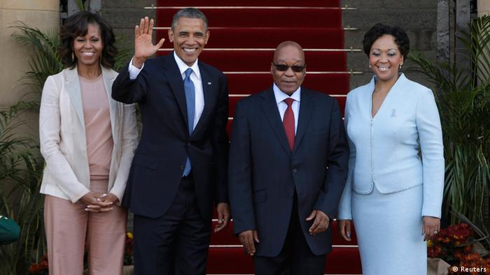 U.S. President Barack Obama (2nd L) waves next to First Lady Michelle Obama (L), South Africa's President Jacob Zuma (2nd R) and his wife, First Lady Thobeka Madiba-Zuma, at the Union Building in Pretoria, June 29, 2013. Obama paid tribute to anti-apartheid hero Nelson Mandela as he flew to South Africa on Friday but played down expectations of a meeting with the ailing black leader during an Africa tour promoting democracy and food security. REUTERS/Gary Cameron (SOUTH AFRICA - Tags: POLITICS)