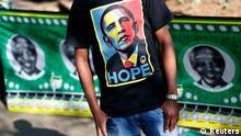 A man wears a t-shirt with a portrait of U.S. President Barack Obama outside the Medi-Clinic Heart Hospital where former South African President Nelson Mandela is being treated in Pretoria June 29, 2013. REUTERS/Kevin Coombs (SOUTH AFRICA - Tags: POLITICS TPX IMAGES OF THE DAY) HEALTH)
