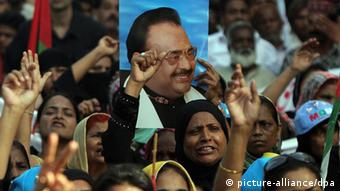 Supporters of Altaf Hussein, the head of Mutahida Qaumi Movement (MQM) political party shout slogans during a protest against Imran Khan, head of Pakistan Tehrik-e-Insaf (PTI) political party, after Khan accused Hussein of killing his party's senior leader Zahra Shahid, in Karachi, Pakistan, 20 May 2013 (Photo: EPA/REHAN KHAN)
