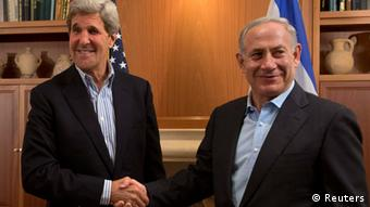 U.S. Secretary of State John Kerry (L) shakes hands with Israel's Prime Minister Benjamin Netanyahu (photo: REUTERS/Jacquelyn Martin/Pool)