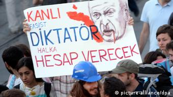 Turkish protestors hold a banner against PM Erdogan during a demonstration in Istanbul, Turkey, 29 June 2013. Photo: EPA/GEORGI LICOVSKI