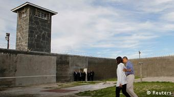 U.S. President Barack Obama tours Robben Island with first lady Michelle Obama, near Cape Town, June 30, 2013. Under apartheid, Nelson Mandela spent several decades as a political prisoner on Robben Island. REUTERS/Jason Reed (SOUTH AFRICA - Tags: POLITICS)
