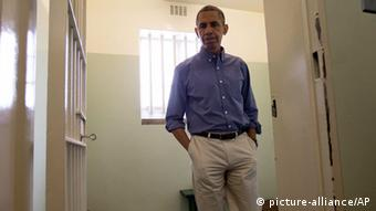 U.S. President Back Obama walks from Section B, prison cell No. 5, on Robben Island, South Africa, Sunday, June 30, 2013. This was former South African president Nelson Mandela's cell, where spent 18-years of his 27-year prison term on the island locked up by the former apartheid government. (AP Photo/Carolyn Kaster)