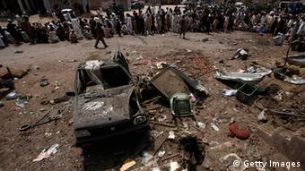 Residents and security officials gather at the site of a bomb attack in the outskirts of Peshawar June 30, 2013. (Photo: Reuters)