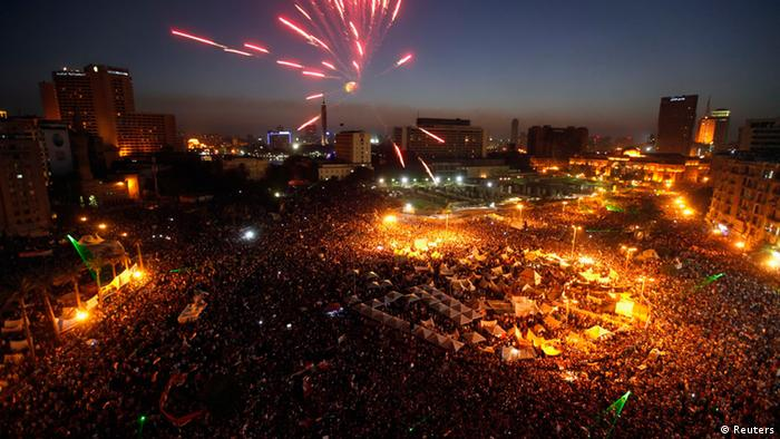 Protesters opposing Egyptian President Mohamed Mursi set off fireworks during a protest at Tahrir Square in Cairo June 30, 2013. Egyptians poured onto the streets on Sunday, swelling crowds that opposition leaders hope will number into the millions by evening and persuade Islamist President Mohamed Mursi to resign. REUTERS/Mohamed Abd El Ghany (EGYPT - Tags: POLITICS CIVIL UNREST CITYSCAPE)