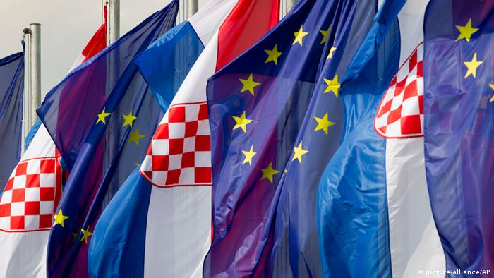 Croatian and the EU flags are seen at an intersection in Zagreb, (AP Photo/Darko Bandic)