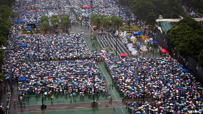 Thousands of pro-democracy protesters gather to march in the streets to demand universal suffrage and urge Hong Kong's Chief Executive Leung Chun-ying to step down in Hong Kong July 1, 2013. Monday marked the 16th anniversary of the territory's handover to China from Britain. REUTERS/Tyrone Siu (CHINA - Tags: POLITICS CIVIL UNREST ANNIVERSARY)