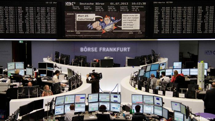 Traders work at their desks in front of the German share price index DAX board REUTERS/Remote/Marte Kiessling