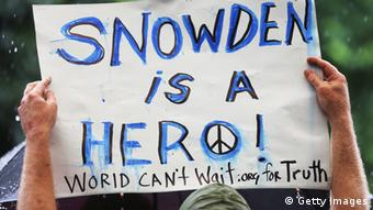 GettyImages 170293810 NEW YORK, NY - JUNE 10: A supporter holds a sign at a small rally in support of National Security Administration (NSA) whistleblower Edward Snowden in Manhattan's Union Square on June 10, 2013 in New York City. About 15 supporters attended the rally a day after Snowden's identity was revealed in the leak of the existence of NSA data mining operations. (Photo by Mario Tama/Getty Images)