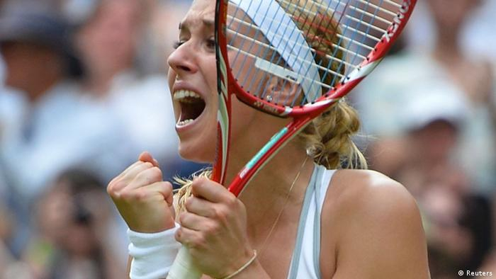 Sabine Lisicki of Germany celebrates after defeating Serena Williams of the U.S. during their women's singles tennis match at the Wimbledon Tennis Championships, in London July 1, 2013. REUTERS/Toby Melville (BRITAIN - Tags: SPORT TENNIS)