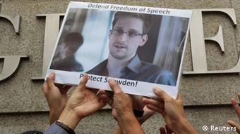 People holding up poster of Edward Snowden REUTERS/Bobby Yip/Files