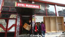 TO GO WITH AFP STORY BY BURAK AKINCIEmployees of the Madimak Hotel hotel in the eastern Turkish city of Sivas empty the building on December 1, 2010. In 1993, 37 Alawite intellectuals died in the hotel after Islamist fundamentalists set it on fire. Alawites, belonging to the largest religious Muslim community in Turkey after the Sunni, want the hotel to become a museum. The Turkish government recently decided to buy and has not met the demand. Alawites are losing hope to have their demands satisfied by the government, which as part of its candidacy to the European Union, says it is reaching out to minorities. Turkish authorities have long tried to assmilate the Alawites, an offshoot of Shiite Islam, preaching a moderate and tolerate interpretation of the Coran. Alawites are considered heretics by many Sunnis because they do not go to the mosque, do not pray five times a day and do not fast during Ramadan. In its progress reports on Turkey's possible adhesion to the European Union, the EU commission regularly denounces the condition of the Alawite community. AFP PHOTO/ADEM ALTAN (Photo credit should read ADEM ALTAN/AFP/Getty Images)