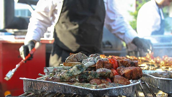 Various kinds of meat at a barbecue event in Berlin by Sven Dörge
