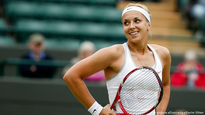 Sabine Lisicki of Germany takes on Kaia Kanepi of Estonia during their quarter-final match for the Wimbledon Championships at the All England Lawn Tennis Club, in London, Britain, 02 July 2013. EPA/KERIM OKTEN