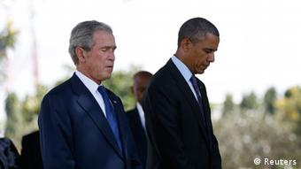 U.S. President Barack Obama and former President George W. Bush (R) attend a memorial for the victims of the 1998 U.S. Embassy bombing in Dar es Salaam July 2, 2013. REUTERS/Jason Reed (TANZANIA - Tags: POLITICS)