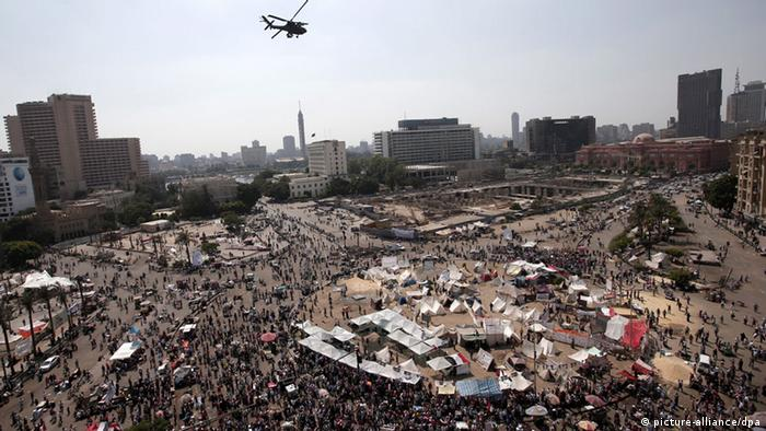 An Egyptian army Apache helicopter flies over Tahrir square as protesters against President Morsi keep demonstrating, in Cairo, Egypt, 02 July 2013. Islamist President Mohamed Morsi on 02 July criticized an ultimatum by the Egyptian military to resolve a deepening political crisis, as his supporters and opponents vowed to continue protesting. Morsi's Muslim Brotherhood group has called on its supporters to take to the streets in support of the president. Protesters opposed to Morsi began arriving at Tahrir Square and near the presidential palace, after opposition groups vowed to demonstrate until the president resigned. (Photo: EPA/ANDRE PAIN)