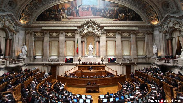Portugal's Prime Minister Pedro Passos Coelho, center standing, addresses lawmakers during a motion of censure tabled by the main opposition Socialist Party in the Portuguese parliament (AP Photo/Francisco Seco)