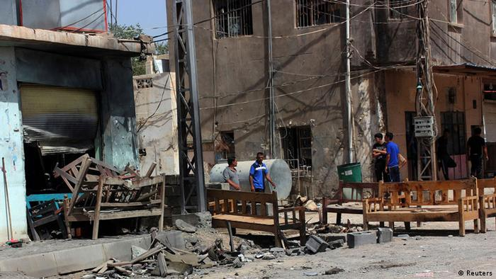 Civilians gather at the site of a suicide bombing attack at a coffee shop in the Shi'ite district of the city of Baquba, about 50 km (31 miles) northeast of Baghdad, July 2, 2013. The separate suicide bombing brought Monday's death toll to 27. No group immediately claimed responsibility for the attacks, but suicide bombings are the trademark of al Qaeda's local affiliate, the Islamic State of Iraq, which security experts say has regained strength in recent months. (Photo via reuters)