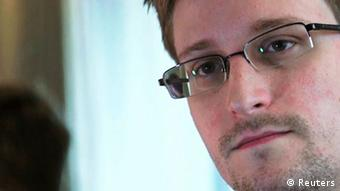 NSA whistleblower Edward Snowden, an analyst with a U.S. defence contractor, is seen in this still image taken from video during an interview by The Guardian in his hotel room in Hong Kong June 6, 2013. Former U.S. spy agency contractor Snowden has applied for political asylum in Russia, a Russian immigration source close to the matter said on July 1, 2013. Picture taken June 6, 2013. REUTERS/Glenn Greenwald/Laura Poitras/Courtesy of The Guardian/Handout via Reuters (CHINA - Tags: POLITICS MEDIA) ATTENTION EDITORS - THIS IMAGE WAS PROVIDED BY A THIRD PARTY. FOR EDITORIAL USE ONLY. NOT FOR SALE FOR MARKETING OR ADVERTISING CAMPAIGNS. NO SALES. NO ARCHIVES. THIS PICTURE WAS PROCESSED BY REUTERS TO ENHANCE QUALITY. NO THIRD PARTY SALES. NOT FOR USE BY REUTERS THIRD PARTY DISTRIBUTORS. MANDATORY CREDIT