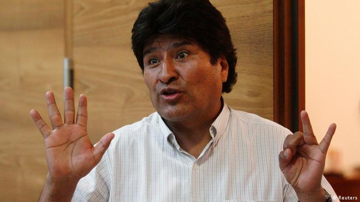 Bolivian President Evo Morales talks to the media as he waits for his flight at the Vienna International Airport in Schwechat July 3, 2013. Morales' plane was diverted on a flight from Russia and forced to land in Austria over suspicions that Edward Snowden might be on board, as several countries spurned the former U.S. spy agency contractor's asylum requests. REUTERS/Heinz-Peter Bader (AUSTRIA - Tags: POLITICS TRANSPORT)