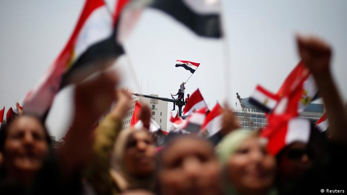 Protesters, who are against Egyptian President Mohamed Mursi, wave flags in Tahrir Square in Cairo July 3, 2013. The general command of the Egyptian armed forces is currently holding a crisis meeting, a military source told Reuters on Wednesday. The meeting was being held hours before the expiry of a deadline set by the army for rival politicians to find a solution to the country's political crisis. REUTERS/Suhaib Salem (EGYPT - Tags: POLITICS CIVIL UNREST TPX IMAGES OF THE DAY)