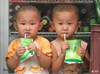 Two Chinese children drink breakfast milk at a store in Beijing Friday Aug. 26, 2005. Government statistics show that 117 boys are born in China for every 100 girls. Birth-control policies which limit many couples to only one child result in some female fetuses being aborted by parents who prefer boys. (AP Photo)