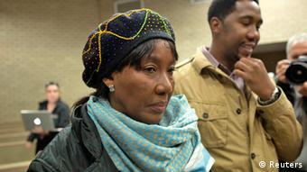 Former South African President Nelson Mandela's daughter Makaziwe Mandela (L) and grandson Ndaba Mandela (C) prepare to leave at the end of a court case concerning the removal of the remains of three of the ailing anti-apartheid hero's children, in the High Court of Mthatha in the Eastern Cape of South Africa July 2, 2013. Sixteen members of the Mandela family have already won a court order forcing Nelson Mandela's grandson Mandla Mandela - officially chief of the Mandela clan - to return the bodies that he dug up two years ago from the village of Qunu, where Nelson Mandela grew up. REUTERS/Siegfried Modola (SOUTH AFRICA - Tags: POLITICS)