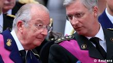 Belgium's King Albert II (L) and Crown Prince Philippe (R) attend a religious service (Te Deum) at the Saint-Gudule cathedral in Brussels in this July 21, 2012 file photo. Belgium's King Albert II will give a televised address to the nation on July 3, 2013, the royal palace said, amid frenzied speculation in the local media that the 79-year-old monarch will step down. REUTERS/Yves Herman (BELGIUM - Tags: PROFILE ROYALS)