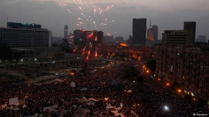 Fireworks over crowd of protesters in Tahrir Square, July 3, 2013. (Photo: REUTERS/Asmaa Waguih)