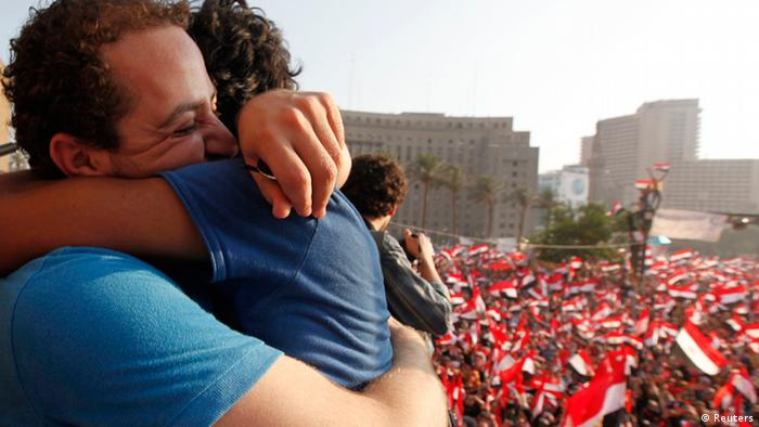 Two demonstrators hug during a protest against Egyptian President Mohamed Mursi in Tahrir Square in Cairo July 3, 2013. The Egyptian president's national security adviser said on Wednesday that a military coup was under way and army and police violence was expected to remove pro-Mursi demonstrators. REUTERS/Mohamed Abd El Ghany (EGYPT - Tags: POLITICS CIVIL UNREST)
