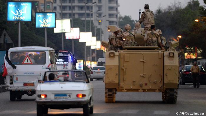 Egyptian army soldiers sit on top of an armoured personnel carrier (APC) in a Cairo street (Photo: KHALED DESOUKI/AFP/Getty Images)