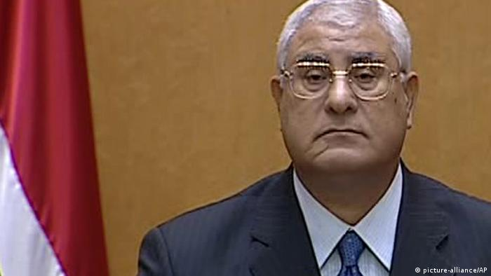This image made from Egyptian State Television shows Egypt's interim president Adly Mansour speaking after being sworn in at the constitutional court in Cairo, Thursday, July 4, 2013. Egypt's chief justice of the Supreme Constitutional Court has been sworn in as interim president after Egyptians awoke Thursday to a new political reality after the military overthrew the country's first democratically elected president after only a year in office, shunting the Islamist leader aside in the same kind of Arab Spring uprising that brought him to power. (AP Photo/Egyptian State TV)