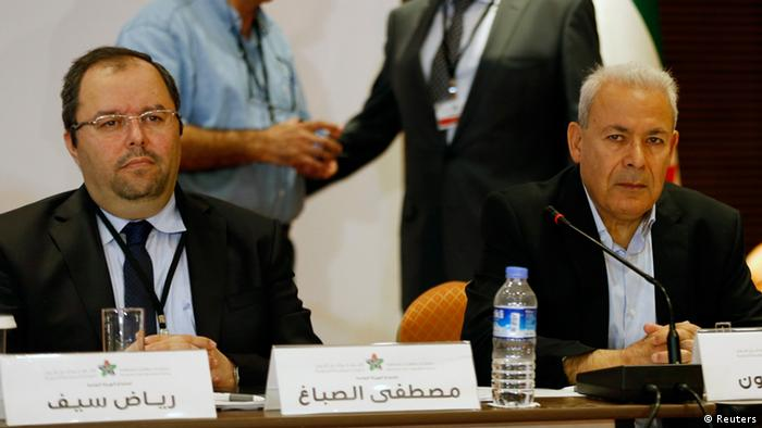 Mustafa Sabbagh (L), Secretary-General of the Syrian National Coalition, and Burhan Ghalioun (R), former President of Syrian National Council, attend a meeting in Istanbul July 4, 2013. Syria's fractious opposition coalition meets on Thursday under pressure to name a new leader and prove to its Western and Arab backers it can be trusted with advanced weapons to beat back a concerted offensive by President Bashar al-Assad. REUTERS/Murad Sezer (TURKEY - Tags: POLITICS)