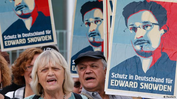 Demonstrators hold banner during protest rally in support of former U.S. spy agency NSA contractor Edward Snowden in Berlin July 4, 2013. The sentence reads: Shelter in Germany for Edward Snowden. (Photo: REUTERS/Tobias Schwarz)