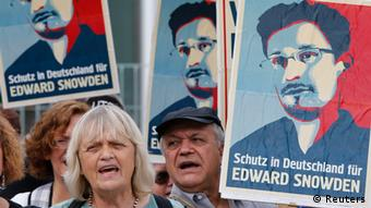 Demonstrators hold banner during protest rally in support of former U.S. spy agency NSA contractor Edward Snowden in Berlin July 4, 2013. (photo: Tobias Schwarz)