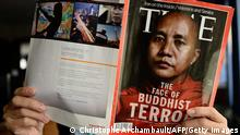 This illustration picture taken on June 24, 2013 in Bangkok shows a man reading a copy of the July 1 issue of Time magazine carrying a picture of controversial Myanmar monk Wirathu on its cover. Myanmar has reacted angrily to a Time magazine cover story on a prominent radical monk accused of fuelling anti-Muslim violence, accompanied by the headline 'The Face of Buddhist Terror'. The Time report 'creates a misunderstanding of Buddhism which has existed for thousands of years and is the religion of the majority of our citizens,' said a statement posted on the presidential office website late on June 23. AFP PHOTO/Christophe ARCHAMBAULT (Photo credit should read CHRISTOPHE ARCHAMBAULT/AFP/Getty Images)