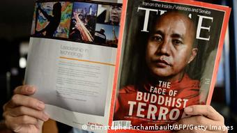 This illustration picture taken on June 24, 2013 in Bangkok shows a man reading a copy of the July 1 issue of Time magazine carrying a picture of controversial Myanmar monk Wirathu on its cover. (Photo: AFP)