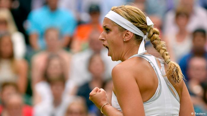 Sabine Lisicki of Germany reacts to winning the first set during her women's semi-final tennis match against Agnieszka Radwanska of Poland at the Wimbledon Tennis Championships, in London July 4, 2013. REUTERS/Toby Melville (BRITAIN - Tags: SPORT TENNIS)