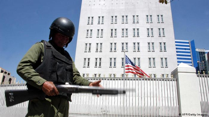 GettyImages 82778460 A police officer stands guard outside the US embassy in La Paz on September 11, 2008 after Bolivian President Evo Morales declared US ambassador Philip Goldberg as a persona non grata. Morales decided to expel Goldberg accusing him of supporting the opposition groups and fomenting division in Bolivia. At least two people were killed and a dozen people wounded in violent clashes between pro- and anti-government protesters in the Bolivian northeastern town of Cobija, stoking fears of further widespread unrest and possibly even civil war. AFP PHOTO/JAVIER MAMANI (Photo credit should read JAVIER MAMANI/AFP/Getty Images)