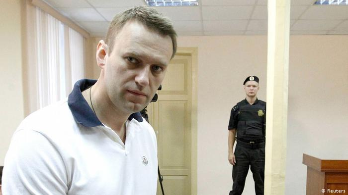 Russian opposition leader and anti-corruption blogger Alexei Navalny attends a court hearing in Kirov July 2, 2013. Russian state prosecutors demanded a six-year jail sentence on Friday for protest leader Navalny, one of President Vladimir Putin's biggest critics, on charges of theft. Picture taken July 2, 2013. REUTERS/Sergei Karpukhin (RUSSIA - Tags: CRIME LAW POLITICS)