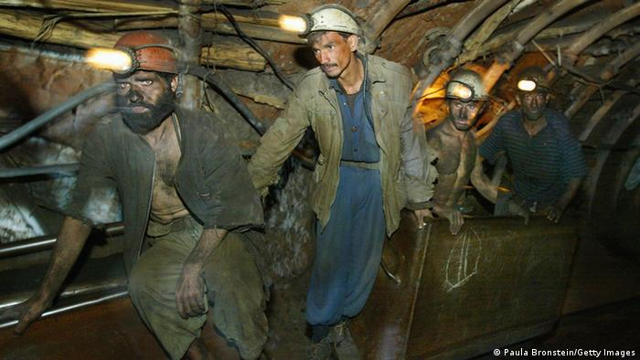 Afghan coal miners use the trolley to exit the mine after their shift is over inside the Karkar mine October 31, 2004 Karkar, Afghanistan. (Photo: AFP)
