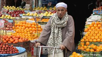 An elderly man is selling oranges on a market in Cairo. (Photo by Jeff J Mitchell/Getty Images)